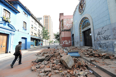 A man walks past a wrecked church in Santiago, Chile on February 27, 2010. (MARTIN BERNETTI/AFP/Getty Images)