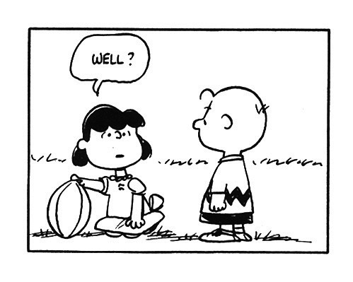 Lucy teasing Charlie Brown.